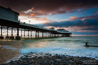 Photo: The Pier at Sunset - Cromer, UK.  A lovely, temperate day and another photographic scene at Cromer Pier during a colorful sunset. Summer in England should always be like this. ... Cromer Pier is located on the north coast of the English county of Norfolk. The pier is one the few working piers left in the country. It is a very popular resort, both for visitors and photographers, more so in the summer when the Pavilion Theatre feature entertainment shows. Still worth a visit in the winter because of its scenic location, with its cliff walks and a charming town nearby.  #Cromer   #England   #UK   #Travel   #Photography   © Yen Baet - www.YenBaet.com. All Rights Reserved. Join me on Facebook at www.facebook.com/YenBaetPhotography.