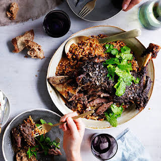 Eight-hour lamb shoulder with Israeli couscous and labne.