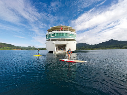 Passenger make use of Paul Gauguin's water sports marina in French Polynesia.