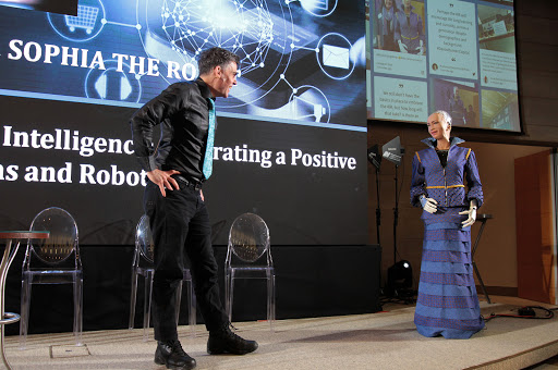 Dr David Hanson on stage with Sophia