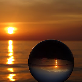 glass sphere in the sunset on the sea by Patrizia Emiliani - Artistic Objects Glass ( glass sphere, sunset, sea )