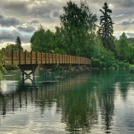 Bridge over Deschutes River in Bend Oregon  by Kathy Dee - Buildings & Architecture Bridges & Suspended Structures ( reflection, bend, deschutes, bridge, river, oregon, water )