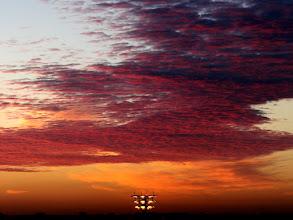 Photo: Fel ochtendrood geprojecteerd op Altocumulus