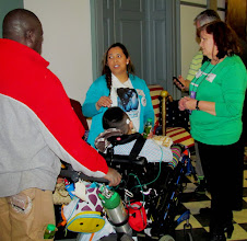 Photo: Nancy Lemus and her son Christopher speak with Terri Hancharick during Disability Day at Legislative Hall on 3.25.15.