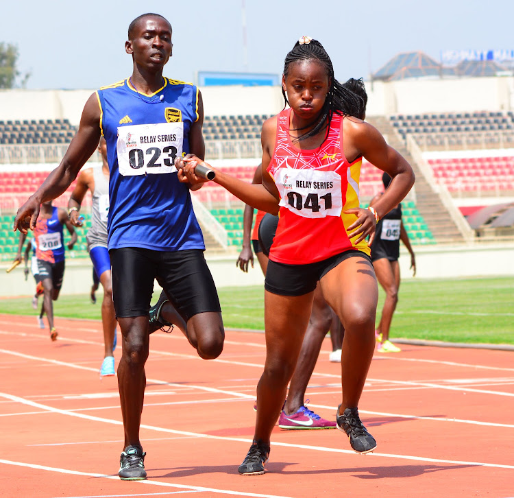 Peter Kithome hands over the baton to Gladys Mumbe in 4x400m relays on January 9