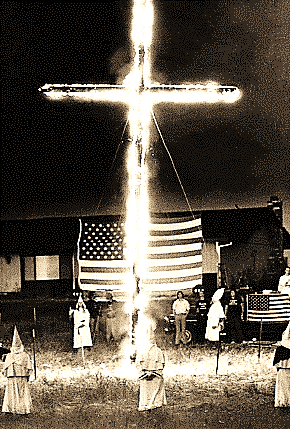 Wilton, CA: About fifty members of the Ku Klux Klan held a cross buring ceremony on a small ranch outside of Sacramento . Gun-toting guards wearing...
