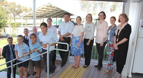 SHOWING US OFF: Narrabri Public School Year 6 students Logan Hanslow, Tashanny Clark and school captain Jinali Trindall are joined by principal Marion Tame, right, in showing a visiting group of Sydneysiders around the school - Neutral Bay Public School principal David Shuster, teacher David Brown, Parliamentary Secretary for Education Gareth Ward, Carlingford West Public School principal Andrew Williamson, Hunters Hill Public School principal Sakuna Pho, Greenacre Public School teacher Abbey McNab, Education Department Parramatta network director Julie Kennedy, West Pymble Public School teacher Maria Greenwood and Greenacre Public School teacher Jackie McDonald.