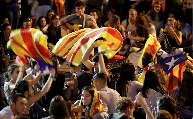 Separatist demonstrators protest after a verdict in a trial over a banned independence referendum in Barcelona