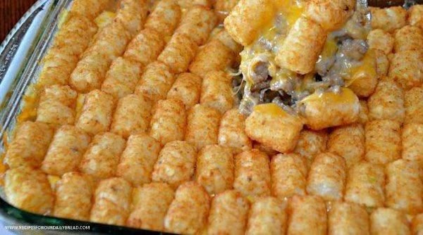Arrange tater tot (or tater rounds) on top of casserole.  Bake for 45...