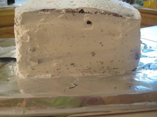 Place the first layer of cake down onto a foiled pan (cookie sheet and...