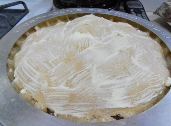 Place top crust on & flute. Cut slits on top for ventilation. Spread on...