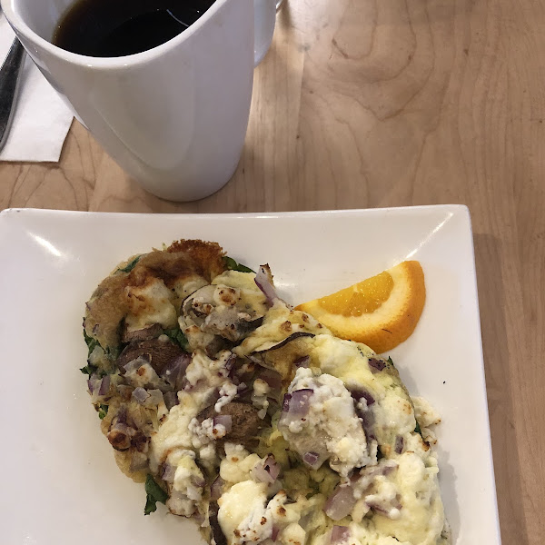 Frittata with feta, onions, mushrooms, and spinach - and a much needed cup of coffee