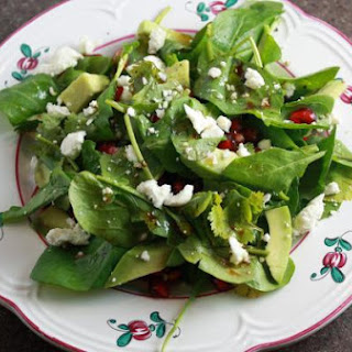 Arugula Salad With Pomegranate, Avocado and Goat Cheese.