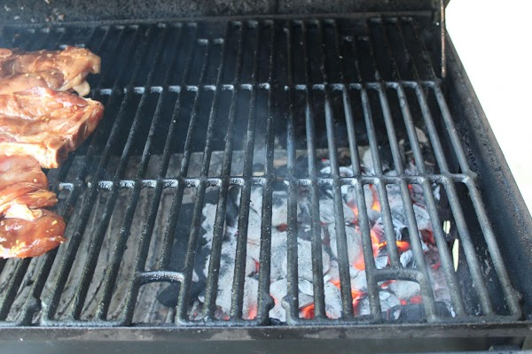 Grill grates with lighted charcoal.