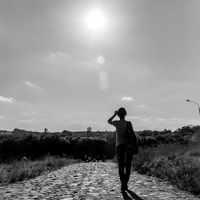 The Girl And A Path by Andrey Dayen - City,  Street & Park  Street Scenes ( girl, ukraine, park, kiev, path, walk, black and white, b&w, portrait, people, city, photography, silhouette )