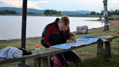 Photo: Viki creating a route on three and four digit (narrow) roads by studying a map he borrowed from library. I wonder how many road trips the map has already witnessed.
