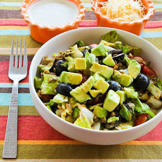 Vegetarian Lentil Taco Salad with Tomatoes, Olives, and Avocado.