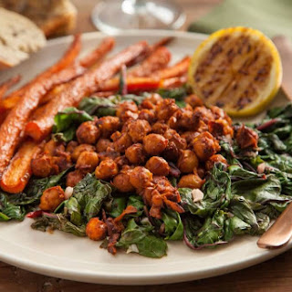 Harissa Chickpeas over Garlic Swiss Chard and Moroccan Spiced Carrots