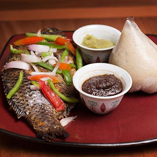 Banku and Tilapia with Pepper Sauce.