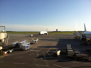 Photo: While waiting at the gate for our flight (plane on the right) another one (left) was being prepared for take-off.