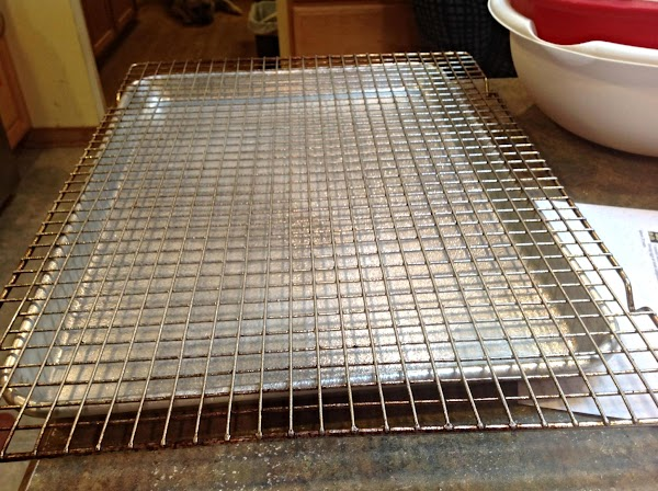 Preheat oven to 450 degrees F. Line a jelly Roll pan with a wire...
