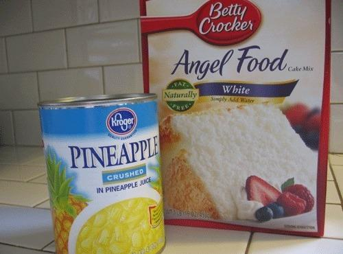 Pour cake mix into large bowl.  Pour crushed pineapple into cake mix and...