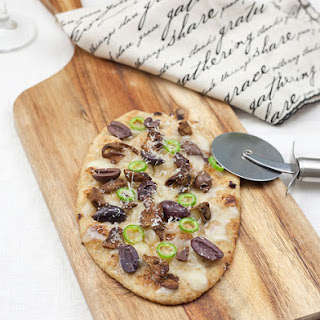 Vegetarian Flatbread Pizzas With Porcini Mushrooms, Olives And Serrano Chili Peppers.