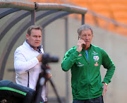 Bafana Bafana coach Stuart Baxter and technical director Neil Tovey in a discussion during the South African national soccer team training session at FNB Stadium on August 16, 2017 in Johannesburg, South Africa.