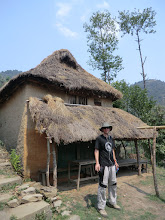 Photo: Lyngve in front of an old house along the trail to Chipling