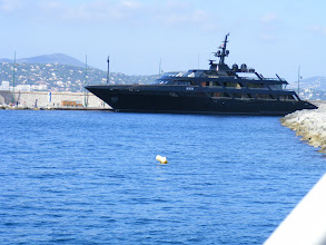 Photo: No, not one of those mega-yachts common here, but instead a very serious looking French naval vessel.