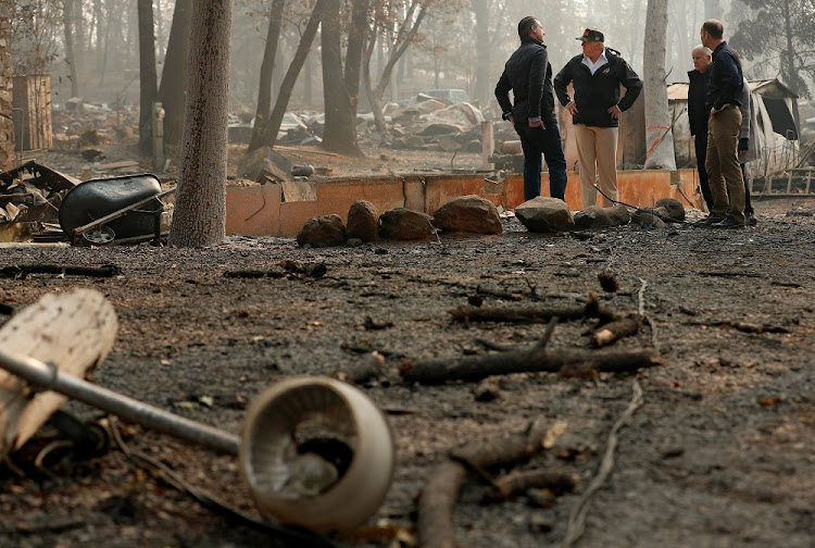 US President Donald Trump visits the Skyway Villa Mobile Home and RV Park, which was destroyed by the 'Camp Fire', with governors of California Jerry Brown, second from right, Brock Long, right, and governor-elect Gavin Newsom, in Paradise, California, the US, November 17 2018. Picture: REUTERS/LEAH MILLS
