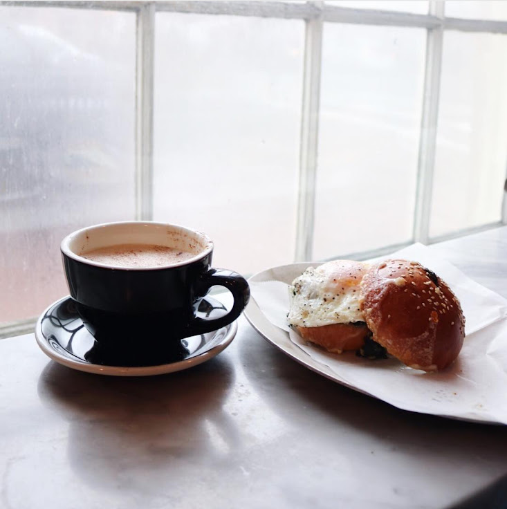 Photo: a cup of chai and a breakfast sandwich at Tatte. Photo: karenxreyes.