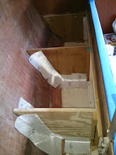 Photo: cutting and dry fitting cloth for the new pilot berth bulkheads