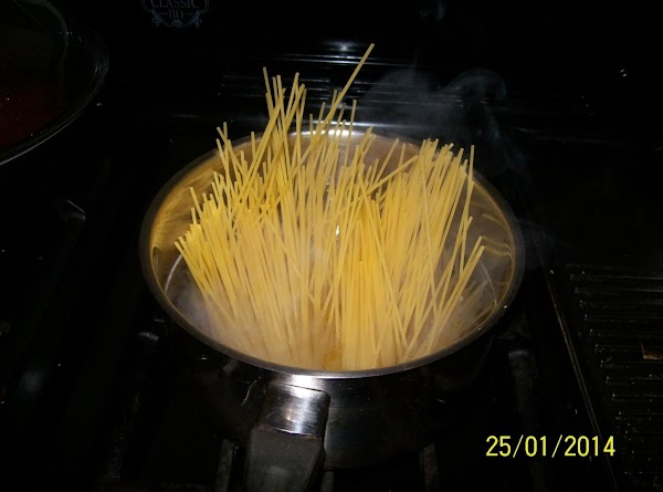 Cook the  spaghetti in a large pan of boiling salted water, add 1...