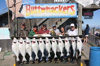 Photo: The gang with their fish. Woke up at 5 to depart at 6:30 back by 4. my fish are # 6 and 7 from the left to right count.