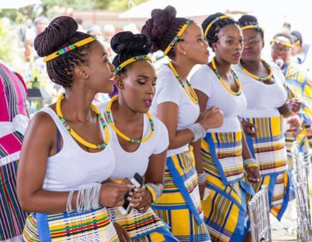 Ladies donning vhaVenda attire at a traditional event.