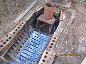 Photo: Fire pit, Combustion chamber ?, bricks not good for long term use,