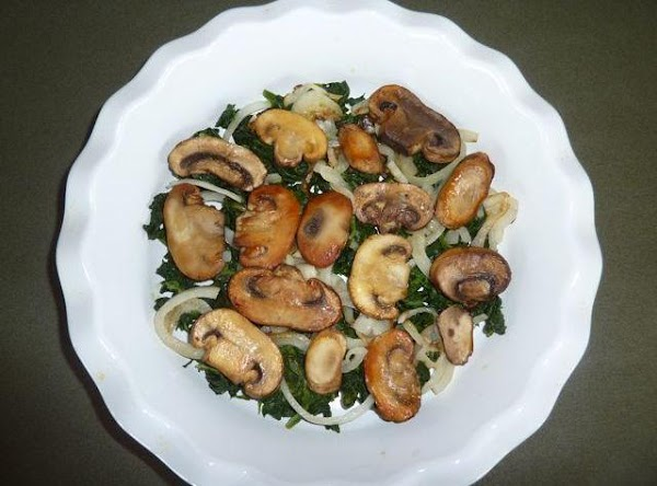 Squeeze excess moisture from the thawed spinach. Arrange the spinach evenly in the bottom...
