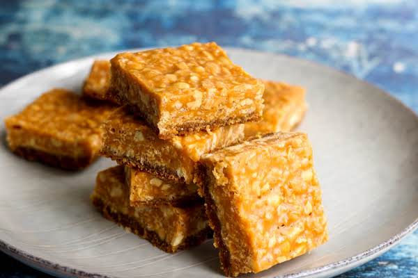 Square Slices Of Butterscotch Krispy Goody Bars On A Plate.