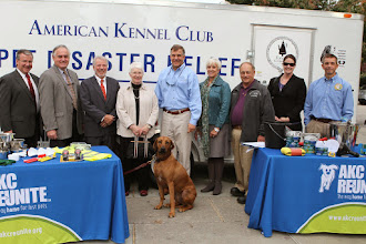 Photo: Dr. Mike Yoder, Chester Lowder, Patrick & Almira Dallas,Bill Gentry, Sharron Stewart, Ernie Wilkinson (Johnston County Animal Services), Dr. Mandy Tolson, Jimmy Tickle...and Clementine the Rhodesian Ridgeback  Credit: Robert Young (c) American Kennel Club