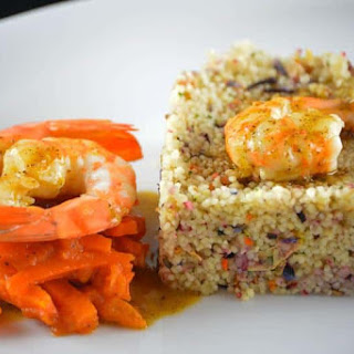 Pan-Fried Shrimp with Vanilla and Orange Sauce and Couscous.
