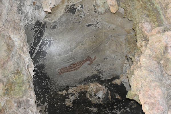 View the ancient painting in the Big Headed Ghost Cave
