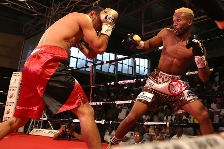 Azinga Fuzile dominated Shavkat Rakhimov as he built a healthy lead until he was floored twice in the eighth round of their IBF elimination clash at the Orient Theatre.
