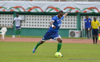 Photo: David Simbo shoots on goal [Leone Stars v Ivory Coast, 6 September 2014 (Pic © Darren McKinstry / www.johnnymckinstry.com)]