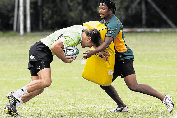 PRESSING TIMES: Johannes 'Boom' Prinsloo and Vuyo Zangqa, assistant coach/manager, during the South African Sevens training session at Victoria Park High School in Port Elizabeth in 2011. Zangqa is now the German Sevens team head coach.