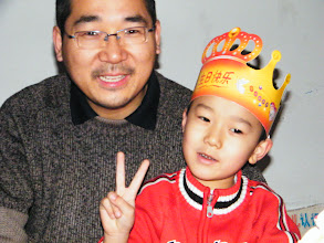 Photo: baby son, warrenzh, 朱楚甲 with his dad benzrad, 朱子卓, who is so contented with his best beloved son.