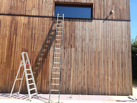 Olieën hout bedrijfsgebouw te Leuven - buitengevel behandelen