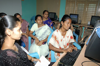 Photo: Our lady instructress on the computer