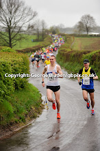Photo: Winner of the Pensford 10k run (no 187, John Collier) and runner up (no 191, Mike Blackmore) lead the field at the start of the race in Pensford, nr Bristol, on Sunday 29th April, 2012
