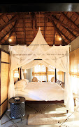 Four-poster beds draped with mosquito nets give some of the suites at Villa iZulu a dreamy feel.